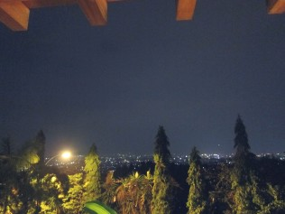 City of Bandung lit up below.