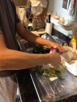 Agent D helping to wash the veggies.