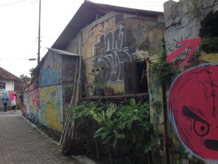 Kampung houses filled with graffiti.