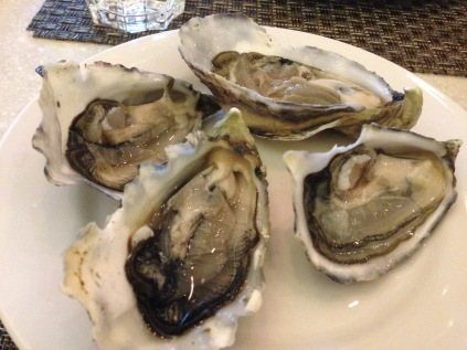 Freshly shucked oysters from France, United States, Canada, Australia and New Zealand.