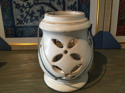 White lantern with tea light holder.
